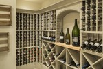 "The Chatham Plan 2472  | <a href=""http://houseplans.co/house-plans/2472/"" title=""The Chatham House Plan 2472"">The Chatham House Plan 2472</a>: The Chatham's wine cellar is compartmentalized for easy organization. Its location just off the kitchen makes it easy for chefs to select excellent wine pairings.  
