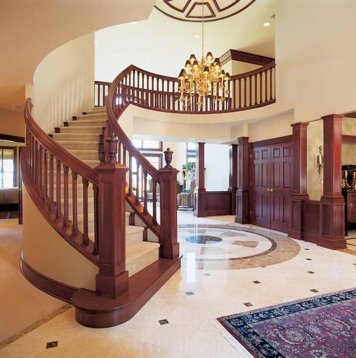 10 home plans with sensational staircases for Curved staircase floor plans