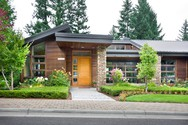 Front Exterior of Mascord House Plan 1410 - The Norcutt